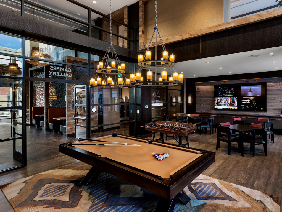 Remy game room with billiards and foosball